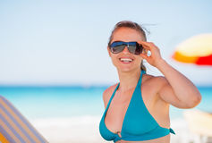 Portrait of smiling woman in sunglasses on beach Royalty Free Stock Image