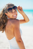Portrait of smiling woman with sunglasses on beach Royalty Free Stock Photo