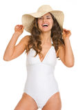 Portrait of smiling woman in swimsuit and hat. Portrait of smiling young woman in swimsuit and hat Royalty Free Stock Photo