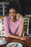 Portrait of smiling woman talking on the mobile phone Royalty Free Stock Image