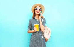 Portrait smiling woman is talking on smartphone holds cup of juice stock images