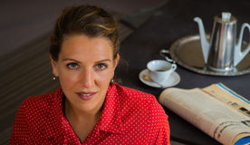 Portrait of a smiling woman at tea time Stock Photography