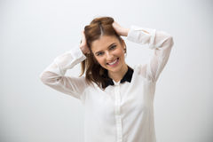 Portrait of a smiling woman touching her hair Royalty Free Stock Photo