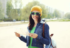 Portrait of smiling woman tourist sightseeing city with map Stock Photography