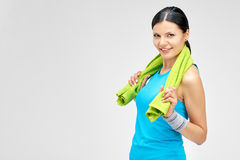 Portrait of smiling woman with towel after exercises Royalty Free Stock Images
