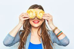 Portrait of smiling woman with two cakes in their eyes. Stock Images