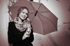 Portrait of smiling woman with umbrella Stock Photo