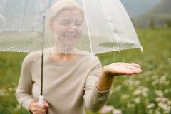 Portrait of smiling woman under umbrella in rain. Portrait of smiling woman under umbrella in rain Stock Photos