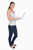 Portrait of a smiling woman using a laptop Stock Photos