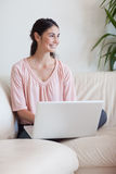 Portrait of a smiling woman using a notebook Royalty Free Stock Image