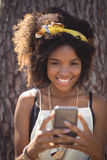 Portrait of smiling woman using smart phone Stock Photography