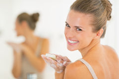 Portrait of smiling woman washing hands with soap Royalty Free Stock Photo