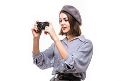 Portrait of a smiling woman wearing beret taking picture with a photo camera isolated over white background royalty free stock photo