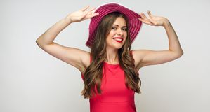 portrait of smiling woman wearing big summer hat. Royalty Free Stock Photography