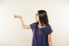 Portrait of a smiling woman wearing eye glasses. hand gestures.  Royalty Free Stock Photo