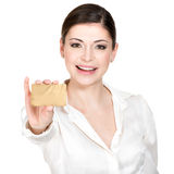 Portrait of smiling woman in a white shirt with credit card Royalty Free Stock Image