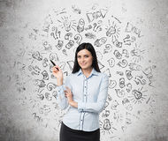 Portrait of smiling woman who points out business icons. Stock Photos