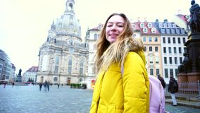 Portrait of smiling woman who walking and posing in camera in beautiful European city Dresden amidst beautiful sights in. Graceful girl broadly smiles and stock video