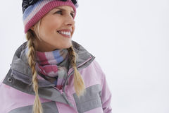 Portrait Of Smiling Woman In Winter Clothing Royalty Free Stock Images