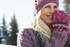 Portrait Of Smiling Woman In Winter Clothing Royalty Free Stock Photography