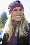 Portrait Of Smiling Woman In Winter Clothing Stock Photos