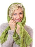 Portrait of a smiling woman wrapped with wool scarf Stock Photography