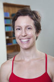 Portrait of smiling woman in a yoga studio, head and shoulders Stock Photography