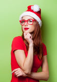 Portrait of a smiling women in christmas hat Royalty Free Stock Photos