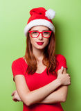 Portrait of a smiling women in christmas hat Stock Photos
