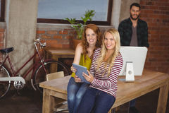 Portrait of smiling women holding digital tablet Stock Photography