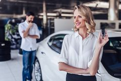 Woman holding keys of new car royalty free stock images