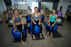 Portrait of Smiling women sitting on fitness ball Stock Photography