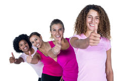 Portrait of smiling women with thumbs up. Against white background Royalty Free Stock Photos