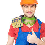 Portrait of smiling worker shows thumbs up Royalty Free Stock Photos