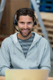 Portrait of a smiling worker wearing a headset. With mic Royalty Free Stock Image