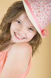 Portrait of a smiling 8 year old girl in a hat. Shot in studio Royalty Free Stock Photo