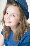Portrait of a smiling 8 year old girl in a hat. Portrait of a smiling 8 year old girl in a hat (studio photography Royalty Free Stock Photo
