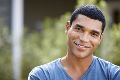 Portrait of smiling young African American man, close up Stock Images
