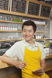 Portrait of smiling young barista with a pad and pen, coffee shop, Beijing Royalty Free Stock Photo