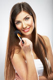 Portrait of smiling  young beautiful woman. Make up brush. Isol Royalty Free Stock Photo