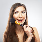 Portrait of smiling  young beautiful woman. Make up brush. Isol Stock Photo