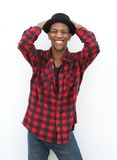 Portrait of a smiling young black man with hat Royalty Free Stock Photo