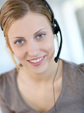 Portrait of smiling young blond teleoperator Royalty Free Stock Photography