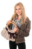 Portrait of smiling young blonde with a handbag Stock Photography