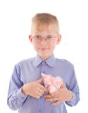 Portrait of smiling young boy gving gift Stock Image