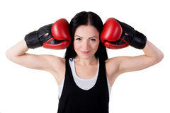 Portrait of a smiling young brunette girl with red boxing gloves Royalty Free Stock Photos