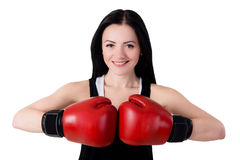 Portrait of a smiling young brunette woman with red boxing glove Royalty Free Stock Image