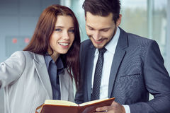 Portrait of a smiling young business couple Stock Photography
