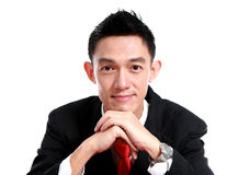 Portrait of a smiling young business man, isolated on white back Royalty Free Stock Images