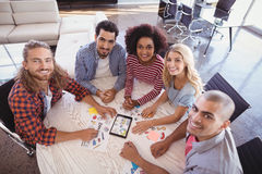 Portrait of smiling young business team sitting at desk Royalty Free Stock Photo